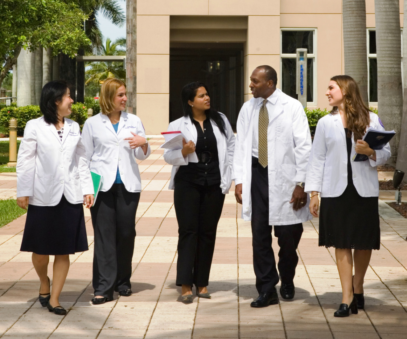 HOPA Recruit a Colleague Program image of pharmacists in white coats talking