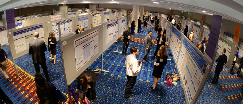 HOPA Research image of people in exhibit hall discussing poster exhibitis